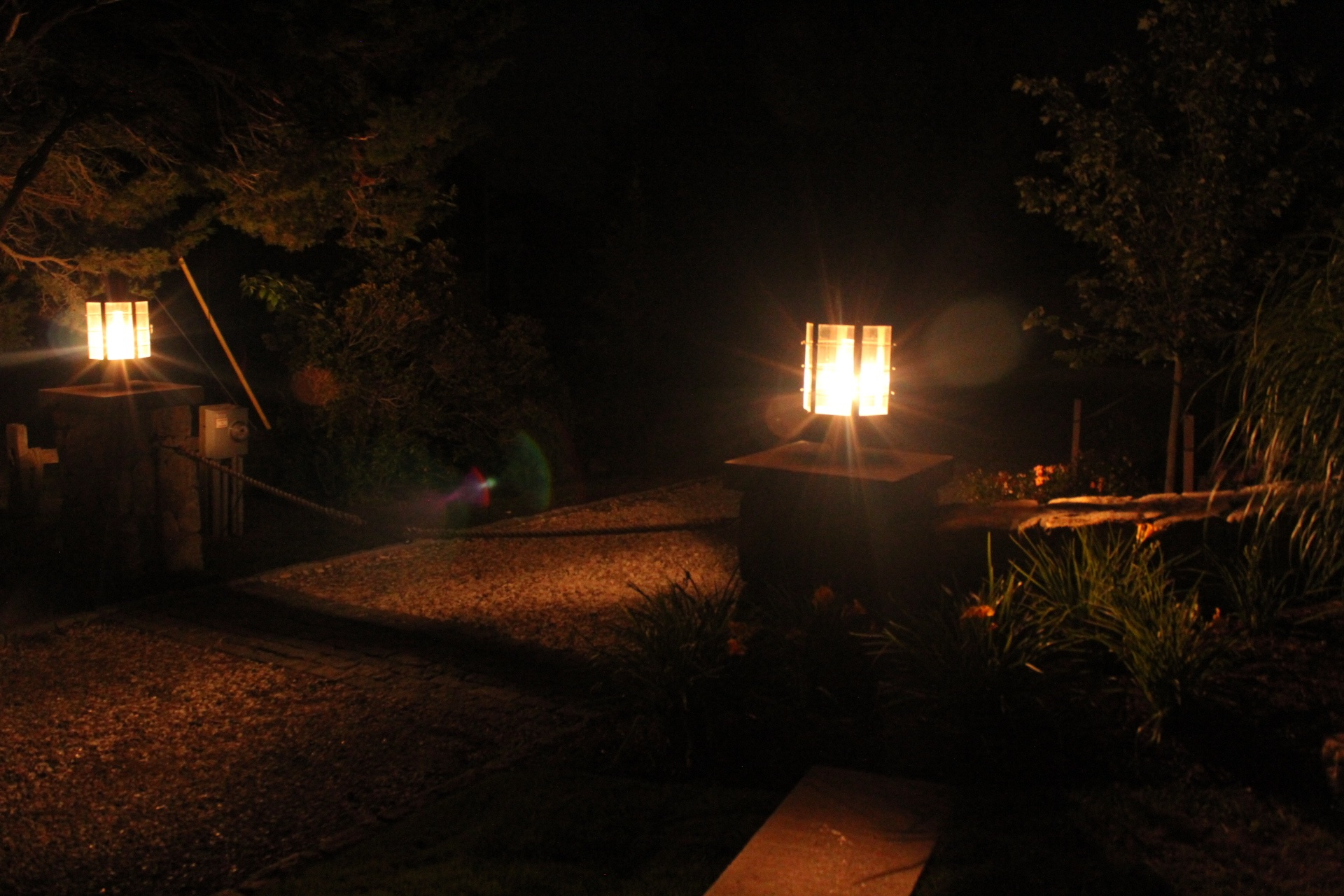 Eastham Home's Guardian Stone Pillars at Night